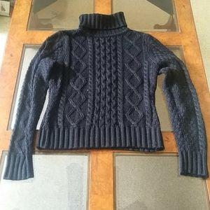 Black turtleneck cable sweater